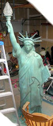 statue of liberty 89 inches tall with glass flame globe
